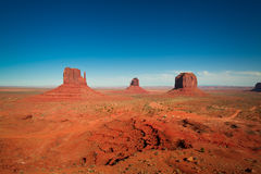 The majestic sandstone masterpieces in the Navajo Nation`s Monument Valley Park. The famous mesa in Utah, USA Royalty Free Stock Photo