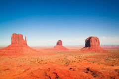 The majestic sandstone masterpieces in the Navajo Nation`s Monument Valley Park. The famous mesa in Utah, USA Royalty Free Stock Images