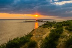 A majestic seascape with colorful sunset. Toned image. Royalty Free Stock Image