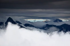 Majestic sharp peaks rise above the clouds, Carnic Alps, Italy Royalty Free Stock Photos