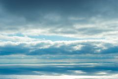 The majestic sky and sea, the view of the horizon. And blue clouds over the water royalty free stock image