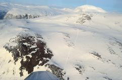 Majestic snowy mountain in northern norway aerial photo Stock Photos