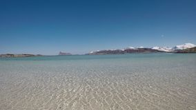 Majestic soft white sand beach under reflecting sea water in early spring stock video