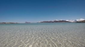 Majestic soft white sand beach under reflecting sea water in early spring stock video footage