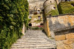 A majestic stone staircase in La Roque-Gageac a charming town in the Dordogne valley. France. A majestic stone staircase in La Roque-Gageac a charming town in stock photo