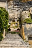 A majestic stone staircase in La Roque-Gageac a charming town in the Dordogne valley. France. La Roque-Gageac, Dordogne, France - September 7, 2018: A majestic royalty free stock photography