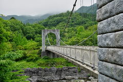 Majestic stony bridge for pedestrians spanning over the green valley in Nikko, Japan Stock Image