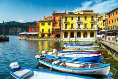Fishing boats in harbor of Malcesine, Veneto region, Italy, Europe Stock Photo