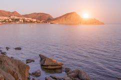 Majestic summer sunset over the sea and mountain. Crimea, Ukraine. Stock Photography