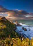 Majestic Sunrise at the Nugget Point Lighthouse, New Zealand. Royalty Free Stock Images