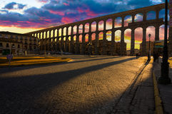 Majestic Sunset Image of the Ancient Aqueduct in Segovia Spain Stock Images