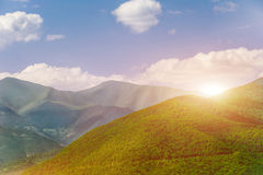 Majestic sunset in the mountains. Majestic sunset in the green mountains landscape stock photos