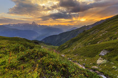Majestic sunset in the mountains Stock Photos