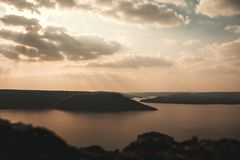 Majestic sunset in the mountains landscape over a calm lake stock photography