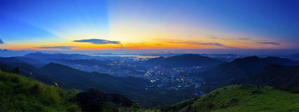 Majestic sunset in the mountains landscape. It is the sunset at Tai Mo Shan, Hong Kong Stock Photos