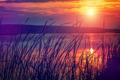 Majestic sunset over the lake. overcast clouds in the sky Royalty Free Stock Photography