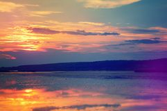 Majestic sunset over the lake. overcast clouds in the sky , Nature Background Royalty Free Stock Photography