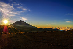 Majestic sunset. Sunset over a volcanic island - view above the clouds Royalty Free Stock Photos