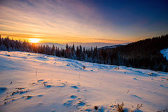 Majestic sunset in the winter mountains landscape. Royalty Free Stock Photo