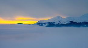 Majestic sunset in the winter mountains landscape Stock Photos
