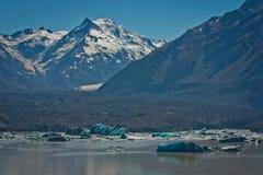 Majestic Tasman glacier and floating icebergs on the Tasman lake, NZ. Impressive picture of glacier, zelandian natural beauty, Mt. Cook national park royalty free stock photos
