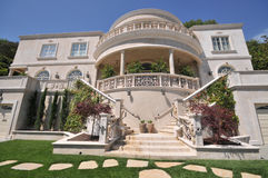 Majestic three story mansion with plenty of steps Stock Photo