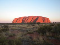 Majestic Uluru at sunset on a clear winter`s evening. In the Northern Territory, Australia Stock Photography