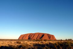 Majestic Uluru at sunset on a clear winter`s evening royalty free stock photography