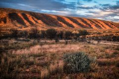 Majestic Uluru at sunset on a clear winter`s evening in the Northern Territory, Australia. Aerial view of Great Ocean Road coastline at sunset, Australia.The Royalty Free Stock Photography