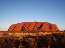 Majestic Uluru at sunset on a clear winter`s evening. In the Northern Territory, Australia Stock Images