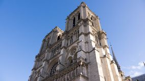 Majestic and unique Cathedral of Notre Dame. Low angle view of the famous Cathedral of Notre Dame in Paris, France Stock Photo