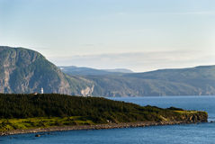 Majestic View. Newfoundland Lighthouse shown in Wide View with Majestic Coastline in Background Royalty Free Stock Photo