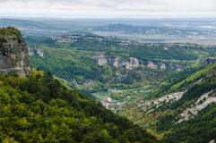 Majestic view from above on Crimean mountains. Covered by golden, yellow and green autumn forests Stock Image