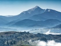 Majestic view of great ukrainian mountains. Misty hills and meadows. Wonderful nature scenery of Carpathians royalty free stock photos