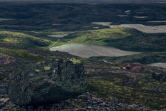 Majestic view of the green valley and the lake from the top of the mountain. Arctic summer, the tundra, Norway royalty free stock image