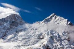 Majestic View of High Altitude Snowbound Mountain Peaks Stock Photos