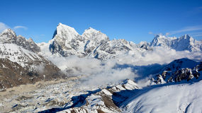 Majestic view of the Himalayan mountains from Mt. Gokyo Ri. Mountain range covered with snow on the background of blue sky Royalty Free Stock Photo