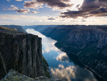 Majestic view of the Lysefjorden, with mountains on the sunset. The mountain Kjerag in Forsand municipality in Rogaland county, Norway stock images
