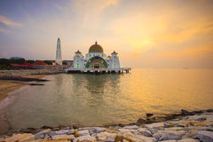 Majestic view of Malacca Straits Mosque during sunset Stock Image