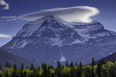 Majestic view of mountain from lookout point. Majestic view of mountain with cloud hovering above peak from lookout point stock photography