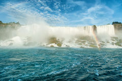 Majestic view on the Niagara Falls. In daylight from the water Royalty Free Stock Photography