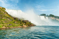 Majestic view on the Niagara Falls. In daylight from the water Royalty Free Stock Photos