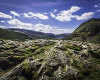 Majestic view on scenic mountain valley with lake in Snowdonia, UK. Majestic view on scenic mountain valley in Snowdonia, North Wales, UK, in springtime.Rocky stock photos