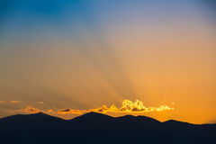 Majestic vivid sunset/sunrise over dark mountains Stock Image