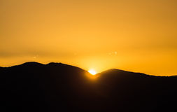 Majestic vivid sunset/sunrise over dark mountains Royalty Free Stock Image