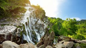 Majestic water cascade of Powerscourt Waterfall, the highest waterfall in Ireland. Tourist atractions in co. Wicklow, Ireland
