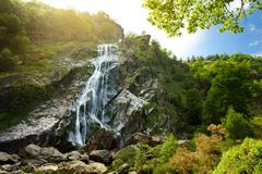 Majestic water cascade of Powerscourt Waterfall, the highest waterfall in Ireland. Famous tourist atractions in co. Wicklow, Ireland royalty free stock photos