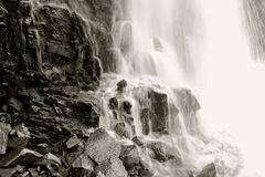 Majestic Waterfall. With dark rocks and blurry water flowing down Davis Creek in Farmington Utah Stock Photography