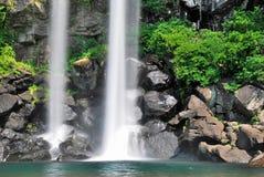 Majestic waterfall falling into creek royalty free stock photography
