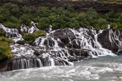 Majestic waterfalls with rocks and grass around Royalty Free Stock Photography